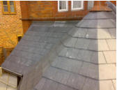 close mitered hip  on slate roof in chester